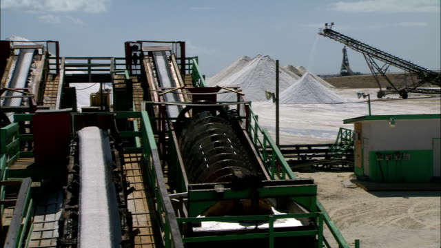 machinery processes salt at a mine. - mineral stock videos & royalty-free footage