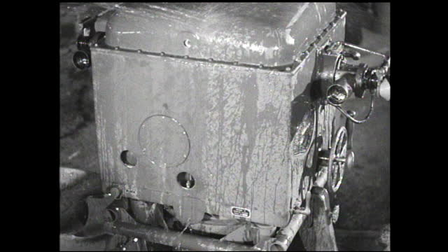 machinery with knobs, gear cranks, and views rotating while being hosed off - 1940 1949 video stock e b–roll