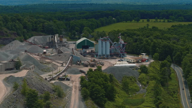 machinery working on the open-cast quarry in poconos, pennsylvania. aerial drone video with the partial orbiting camera motion. - pennsylvania stock videos & royalty-free footage