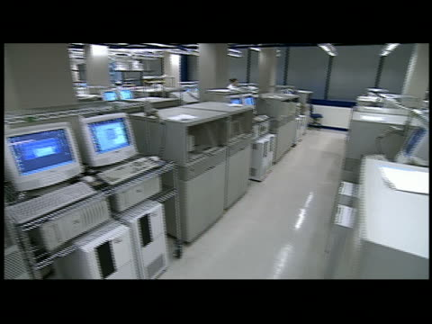 ms  pan machines and computers in genetics lab - only mid adult women stock videos & royalty-free footage