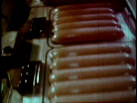 vidéos et rushes de 1970 montage machines help seal the packaging on meat products with plastic at oscar mayer facility - conditionnement