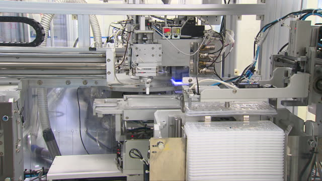 machines moving at a contact lens manufacturing factory - contact lens case stock videos and b-roll footage