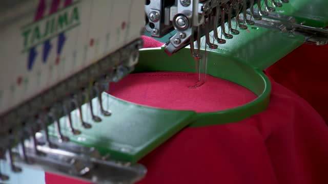 machines printing and sewing brands on clothing - sewing stock videos & royalty-free footage