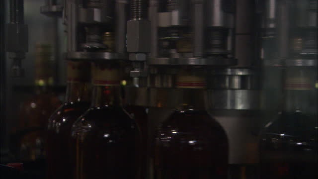 machines seal and label bottles of rum. - rum stock videos and b-roll footage