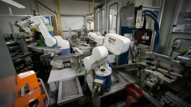 Machines sorting brushes at production facility / robot arms Machine Sorting Brushes at Gordon Brush Manufacturing Co Inc on January 10 2012 in...