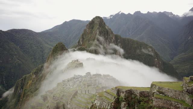 machu picchu ruins covered by fog - machu picchu stock videos & royalty-free footage