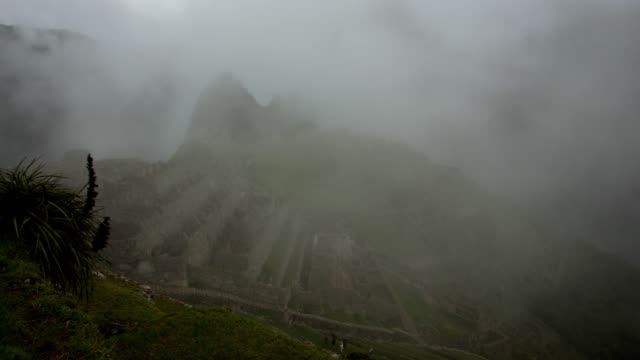 Machu Picchu with mist and mountains