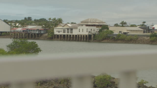 mackay leisure boat beached sitting on sand flats low tide out / old stilt pylon waterfront queenslander houses on the side of pioneer river / side... - tide out stock videos & royalty-free footage