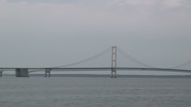 mackinac bridge 1 - hd 1080/60i - boat point of view stock videos & royalty-free footage