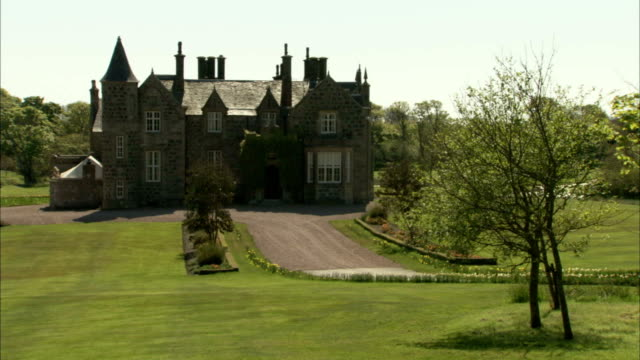 macleod house w/ wide driveway w/ trees around uk donald trump trump international golf links trump golf balmedie aberdeenshire - golf links stock videos & royalty-free footage