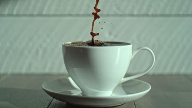 macro close up coffee pour splash cup - jug stock videos & royalty-free footage