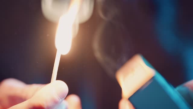 macro close up of a match striking against a matchbox and igniting, on january 10 2021, in bristol, united kingdom. - macro stock videos & royalty-free footage