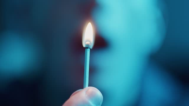 macro close up of a match striking against a matchbox and igniting, then blowing it out, on january 10 in bristol, united kingdom. - macro stock videos & royalty-free footage