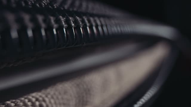 macro close up of a zip being opened on a luggage bag or suitcase, on july 3 2021 in bristol, united kingdom. - macro stock videos & royalty-free footage