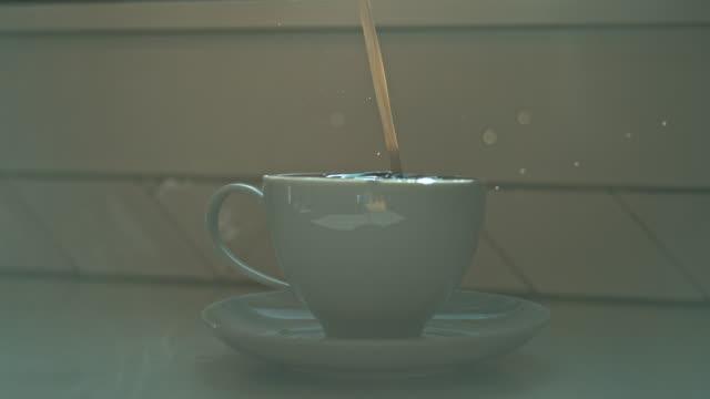 macro creamer milk pour coffee cup morning - jug stock videos & royalty-free footage
