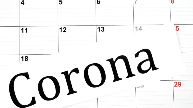 "macro dolly: calender with ""corona"" written on it - week video stock e b–roll"