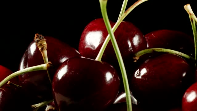 Macro dolly: cherries on black