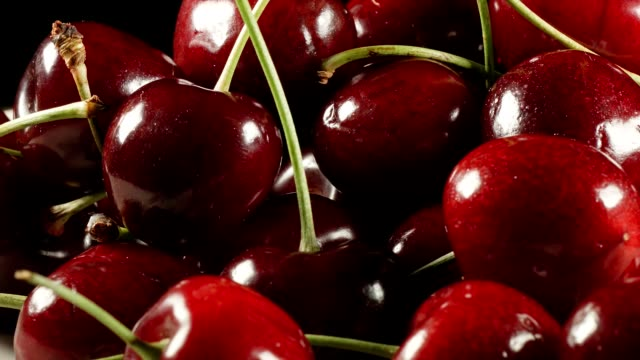 macro dolly: cherries on black - cherry stock videos & royalty-free footage