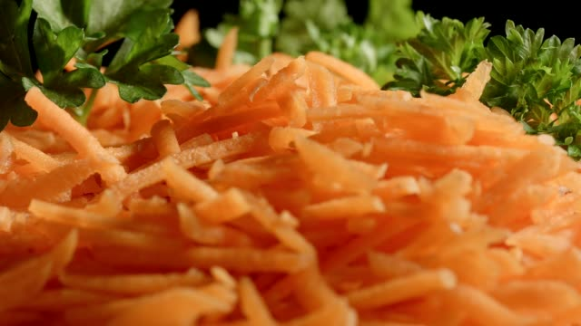 macro dolly: grated carrots with parsley - parsley stock videos and b-roll footage
