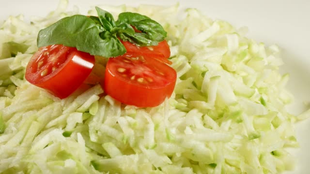 macro dolly: grated zucchinis with tomato and basil - grated stock videos & royalty-free footage
