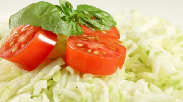 Macro Dolly: Grated Zucchinis with tomato and basil