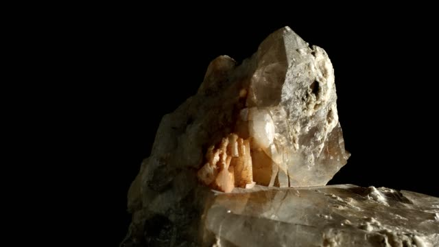 Macro dolly: Quartz crystal on black