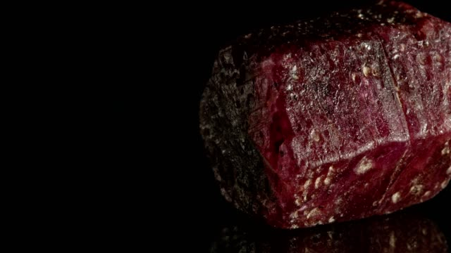 macro dolly: ruby crystal on black - stone object stock videos and b-roll footage