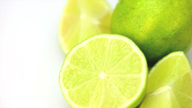 hd macro dolly shot of limes - frische stock videos & royalty-free footage