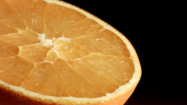 Macro dolly: Sliced Orange on black background