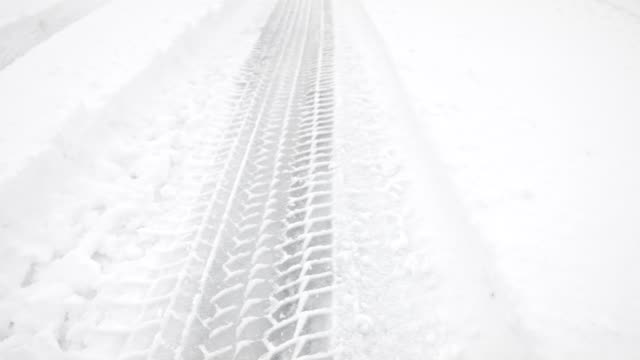macro dolly: tire tracks in fresh snow - tire track stock videos & royalty-free footage