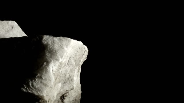 Macro dolly: white marble on black background