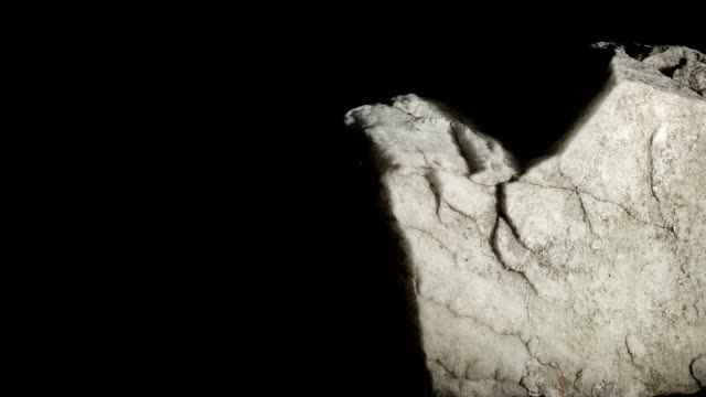 macro dolly: white marble on black background - stone material stock videos & royalty-free footage