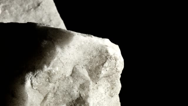 macro dolly: white marble on black background - marble rock stock videos and b-roll footage