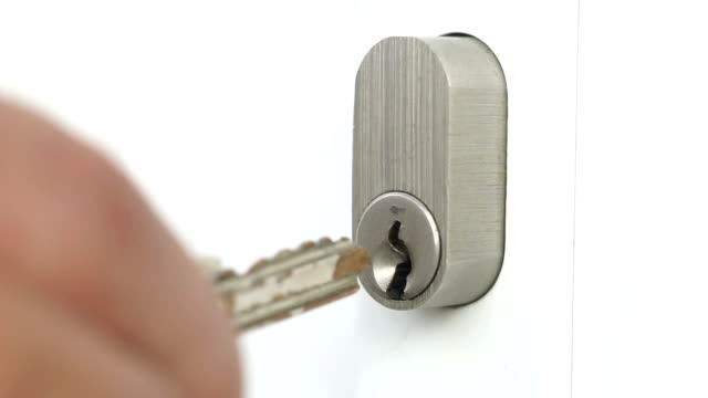 macro keys opening and closing front doors - lock stock videos & royalty-free footage