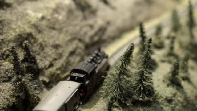macro of an old steam train model on a pike layout - locomotive stock videos & royalty-free footage