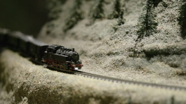 macro of an old steam train model on a pike layout - history stock videos & royalty-free footage