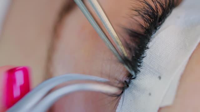 Macro of extension eyelash application