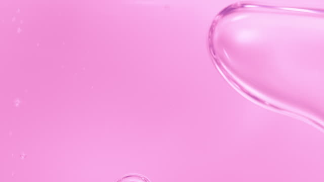 vídeos de stock e filmes b-roll de macro pink liquid bubbles slow movement in high speed - liquid