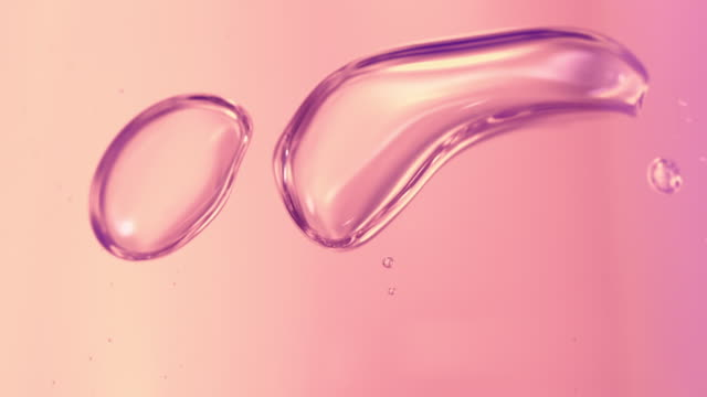 vidéos et rushes de macro pink liquid bubbles slow movement in high speed - pink color
