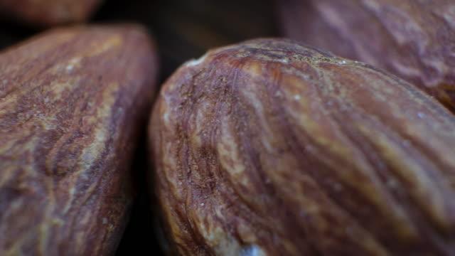 slo mo macro shot almond seeds macro - almond stock videos & royalty-free footage