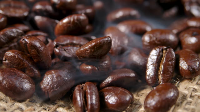 macro shot dark coffee bean with smoke - refreshment stock videos & royalty-free footage
