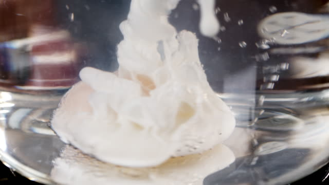 macro shot of an egg being dropped into boiling water. - boiling stock videos & royalty-free footage