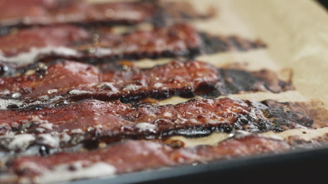 macro shot of bacon tray being placed onto table top. - bacon stock videos & royalty-free footage
