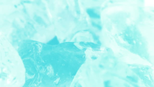 macro shot of blue crystal clear ice cubes in blue light. - cracked stock videos & royalty-free footage