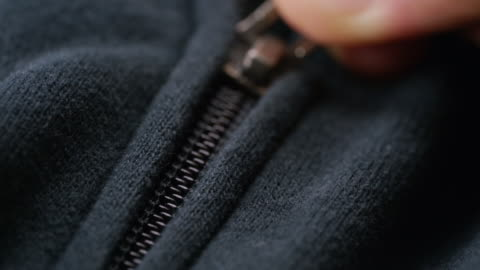 macro shot of hand zipped on cloth - pocket stock videos & royalty-free footage