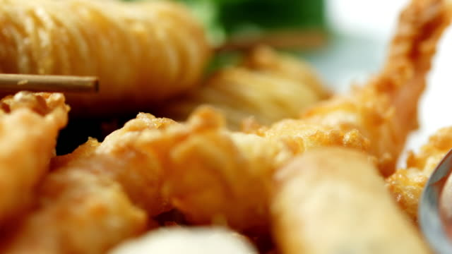 macro shot of tempura appetisers on a plate with dips. - crustacean stock videos & royalty-free footage