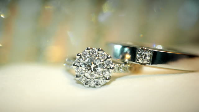 macro shot of wedding rings with textured background. wedding theme. - ring stock videos and b-roll footage