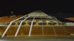 Macro shot through an electric guitar that is laying down