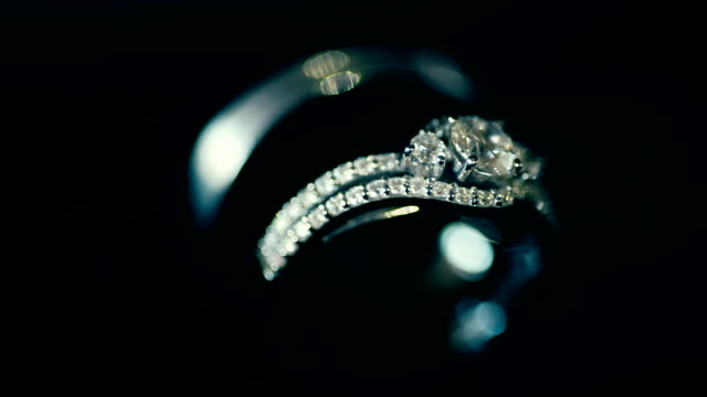 macro shot wedding rings in the dark. wedding theme. - stone object stock videos & royalty-free footage