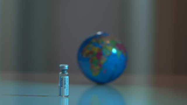 macro uhd video of coronavirus, covid-19 pandemic disease vaccine bottle - selimaksan video stock e b–roll